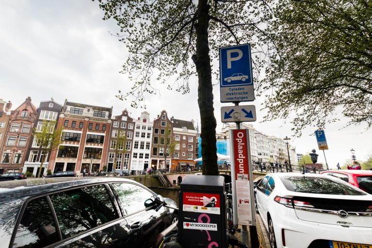 The same policies that made electric vehicles popular, such as private charging stations and free parking spaces, are jeopardising further growth in electric transport.