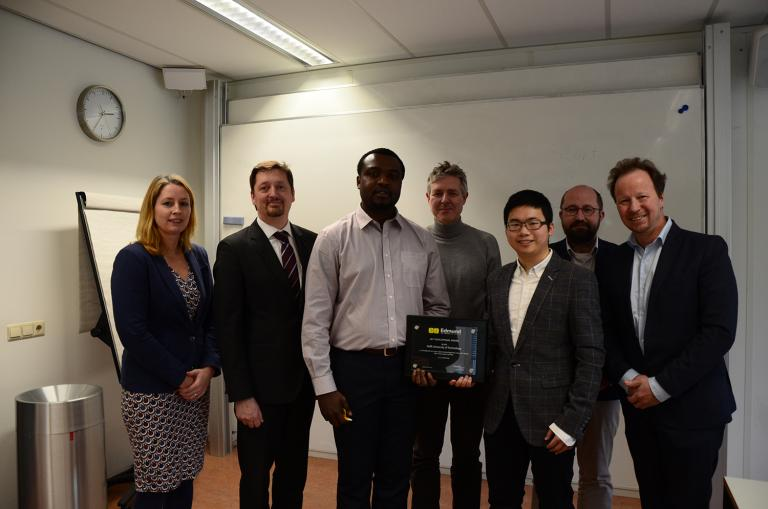 Tope Agbana and Hai Gong holding the award, flanked by Professor Michel Verhaegen (right) (Photo: Anqi Fu)