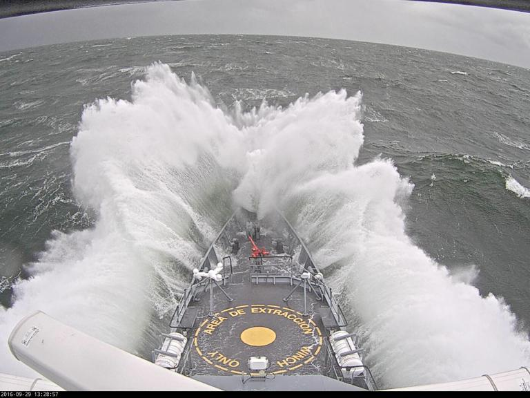 Ship ploughing through wave