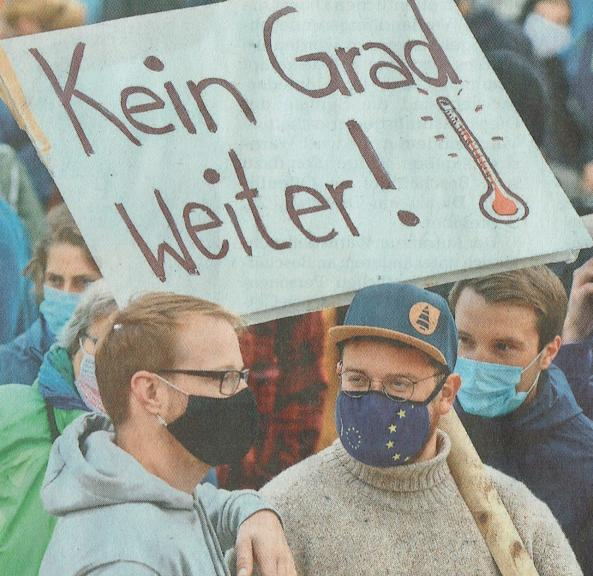 Florian (in the middle) at a climate protest